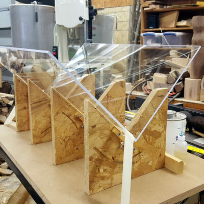 Plexiglas laid on jigs for aligning the pieces at a 90 degree angle